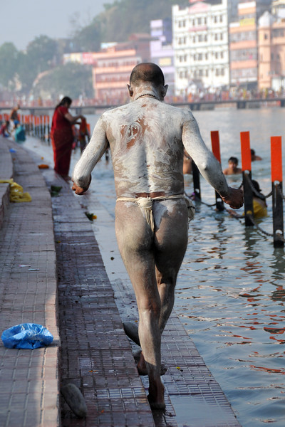 Naga Sadhu (monks) wash up in the holy Ganga river.<br /> <br /> Kumbh Mela is the biggest religious gatherings on the planet which takes places on the banks of the river Ganga. The number of pilgrims this year is expected to exceed around five million since the first day Jan 14 till the time it concludes on April 28, 2010. The auspicious days of the shahi snan or royal baths usually draw hundreds of thousands of devotees to the Har Ki Paudi and other banks of the river. Uttarakhand. North India. The occasion draws pilgrims from around the world and severly overloads the infrastructure so most of the city is shut down for any vehicles other than security or emergency services so a sea of humanity walks through the city to get to the bathing ghats.