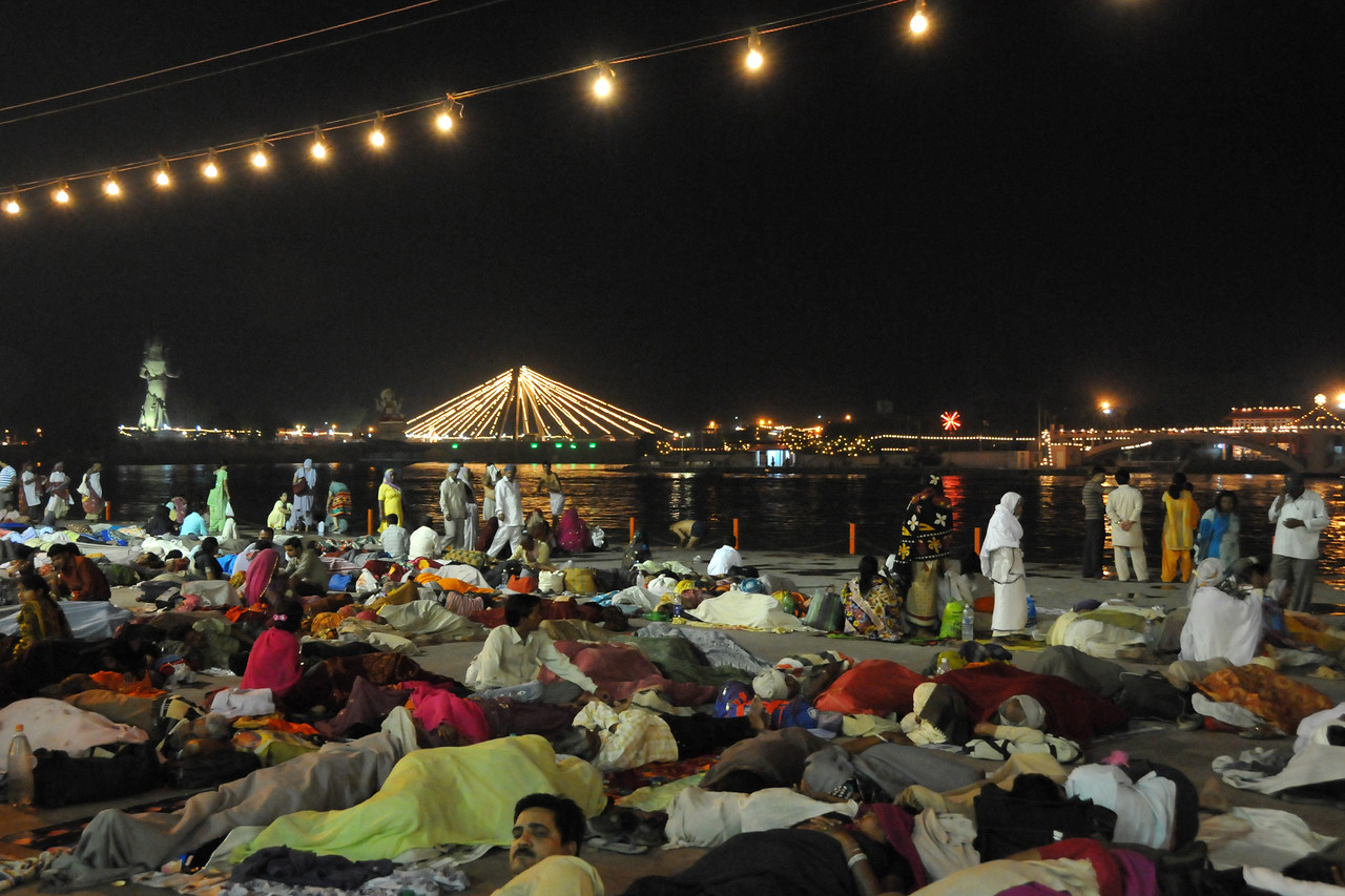 With hundreds of thousands of pilgrims in Haridware for the Kumbh Mela, people found any nook and corner to lay down and sleep literally on the streets.<br /> <br /> Kumbh Mela is the biggest religious gatherings on the planet which takes places on the banks of the river Ganga. The number of pilgrims this year is expected to exceed around five million since the first day Jan 14 till the time it concludes on April 28, 2010. The auspicious days of the shahi snan or royal baths usually draw hundreds of thousands of devotees to the Har Ki Paudi and other banks of the river. Uttarakhand. North India.