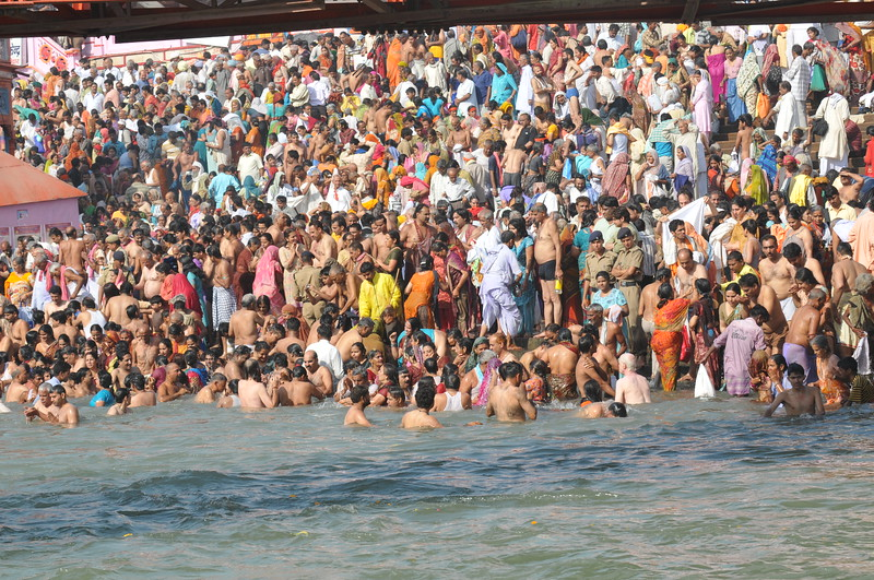 Thousands taking a holy bath in the river Ganga at Hari Ki Pauri, Haridwar.<br /> <br /> Kumbh Mela is the biggest religious gatherings on the planet which takes places on the banks of the river Ganga. The number of pilgrims this year is expected to exceed around five million since the first day Jan 14 till the time it concludes on April 28, 2010. The auspicious days of the shahi snan or royal baths usually draw hundreds of thousands of devotees to the Har Ki Paudi and other banks of the river. Uttarakhand. North India. The occasion draws pilgrims from around the world and severly overloads the infrastructure so most of the city is shut down for any vehicles other than security or emergency services so a sea of humanity walks through the city to get to the bathing ghats.