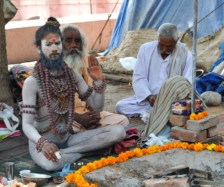 Naga sadhus (naked monks) renounce everything including cloths and rub ash and mud on their bodies. They live only in prayers. Typically with a dhuni (fireplace) in front and chilam (pipe with hashish) they spend time in prayers and meditation. arrives. During Kumbh Mela, the Naga sadhus bless those who come to them.<br /> <br /> <br /> Kumbh Mela is the biggest religious gatherings on the planet which takes places on the banks of the river Ganga. The number of pilgrims this year is expected to exceed around five million since the first day Jan 14 till the time it concludes on April 28, 2010. The auspicious days of the shahi snan or royal baths usually draw hundreds of thousands of devotees to the Har Ki Paudi and other banks of the river. Uttarakhand. North India. The occasion draws pilgrims from around the world and severly overloads the infrastructure so most of the city is shut down for any vehicles other than security or emergency services so a sea of humanity walks through the city to get to the bathing ghats.