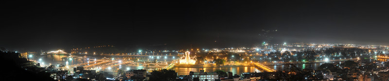 Panoramic night view of Haridwar at the time of Kumbh Mela in April, 2010.  Kumbh Mela is the biggest religious gatherings on the planet which takes places on the banks of the river Ganga. The number of pilgrims this year is expected to exceed around five million since the first day Jan 14 till the time it concludes on April 28, 2010. The auspicious days of the shahi snan or royal baths usually draw hundreds of thousands of devotees to the Har Ki Paudi and other banks of the river. Uttarakhand. North India. The occasion draws pilgrims from around the world and severly overloads the infrastructure so most of the city is shut down for any vehicles other than security or emergency services so a sea of humanity walks through the city to get to the bathing ghats.