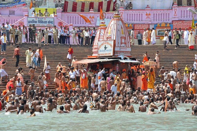Naga sadhus taking a bath in the Kumbh Mela, Haridwar.<br /> <br /> Kumbh Mela is the biggest religious gatherings on the planet which takes places on the banks of the river Ganga. The number of pilgrims this year is expected to exceed around five million since the first day Jan 14 till the time it concludes on April 28, 2010. The auspicious days of the shahi snan or royal baths usually draw hundreds of thousands of devotees to the Har Ki Paudi and other banks of the river. Uttarakhand. North India.