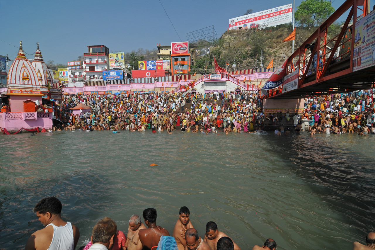 Various ghats packed with people taking a dip in the holy Ganga river in Haridwar.<br /> <br /> Kumbh Mela is the biggest religious gatherings on the planet which takes places on the banks of the river Ganga. The number of pilgrims this year is expected to exceed around five million since the first day Jan 14 till the time it concludes on April 28, 2010. The auspicious days of the shahi snan or royal baths usually draw hundreds of thousands of devotees to the Har Ki Paudi and other banks of the river. Uttarakhand. North India. The occasion draws pilgrims from around the world and severly overloads the infrastructure so most of the city is shut down for any vehicles other than security or emergency services so a sea of humanity walks through the city to get to the bathing ghats.