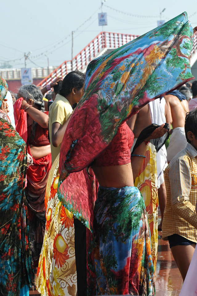 Women drying their cloths in the cool air of Haridwar.<br /> <br /> Kumbh Mela is the biggest religious gatherings on the planet which takes places on the banks of the river Ganga. The number of pilgrims this year is expected to exceed around five million since the first day Jan 14 till the time it concludes on April 28, 2010. The auspicious days of the shahi snan or royal baths usually draw hundreds of thousands of devotees to the Har Ki Paudi and other banks of the river. Uttarakhand. North India. The occasion draws pilgrims from around the world and severly overloads the infrastructure so most of the city is shut down for any vehicles other than security or emergency services so a sea of humanity walks through the city to get to the bathing ghats.