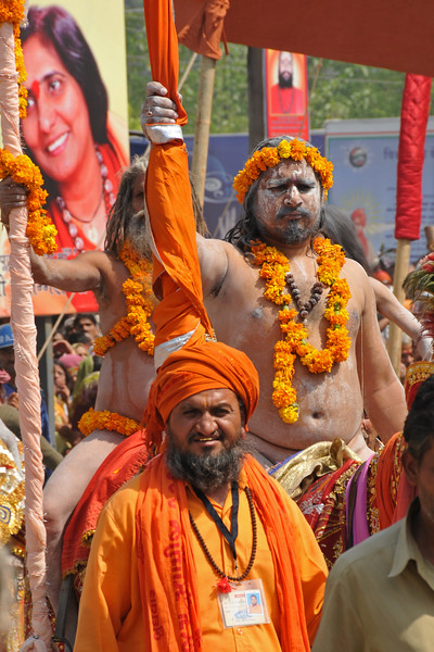 Procession of Naga sadhus arrives. As per tradition, the Naga sadhu's have the first right of bathing in the holy Ganga on the occasion of Kumbh Mela.<br /> <br /> Kumbh Mela is the biggest religious gatherings on the planet which takes places on the banks of the river Ganga. The number of pilgrims this year is expected to exceed around five million since the first day Jan 14 till the time it concludes on April 28, 2010. The auspicious days of the shahi snan or royal baths usually draw hundreds of thousands of devotees to the Har Ki Paudi and other banks of the river. Uttarakhand. North India. The occasion draws pilgrims from around the world and severly overloads the infrastructure so most of the city is shut down for any vehicles other than security or emergency services so a sea of humanity walks through the city to get to the bathing ghats.