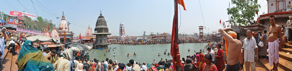 Panoramic view of the thousands taking a holy bath in the river Ganga at Hari Ki Pauri, Haridwar.  Kumbh Mela is the biggest religious gatherings on the planet which takes places on the banks of the river Ganga. The number of pilgrims this year is expected to exceed around five million since the first day Jan 14 till the time it concludes on April 28, 2010. The auspicious days of the shahi snan or royal baths usually draw hundreds of thousands of devotees to the Har Ki Paudi and other banks of the river. Uttarakhand. North India. The occasion draws pilgrims from around the world and severly overloads the infrastructure so most of the city is shut down for any vehicles other than security or emergency services so a sea of humanity walks through the city to get to the bathing ghats.