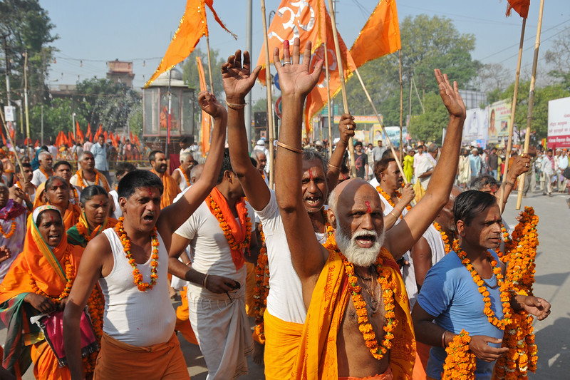 Procession of monks lead the way to the holy river Ganga.<br /> <br /> Kumbh Mela is the biggest religious gatherings on the planet which takes places on the banks of the river Ganga. The number of pilgrims this year is expected to exceed around five million since the first day Jan 14 till the time it concludes on April 28, 2010. The auspicious days of the shahi snan or royal baths usually draw hundreds of thousands of devotees to the Har Ki Paudi and other banks of the river. Uttarakhand. North India. The occasion draws pilgrims from around the world and severly overloads the infrastructure so most of the city is shut down for any vehicles other than security or emergency services so a sea of humanity walks through the city to get to the bathing ghats.