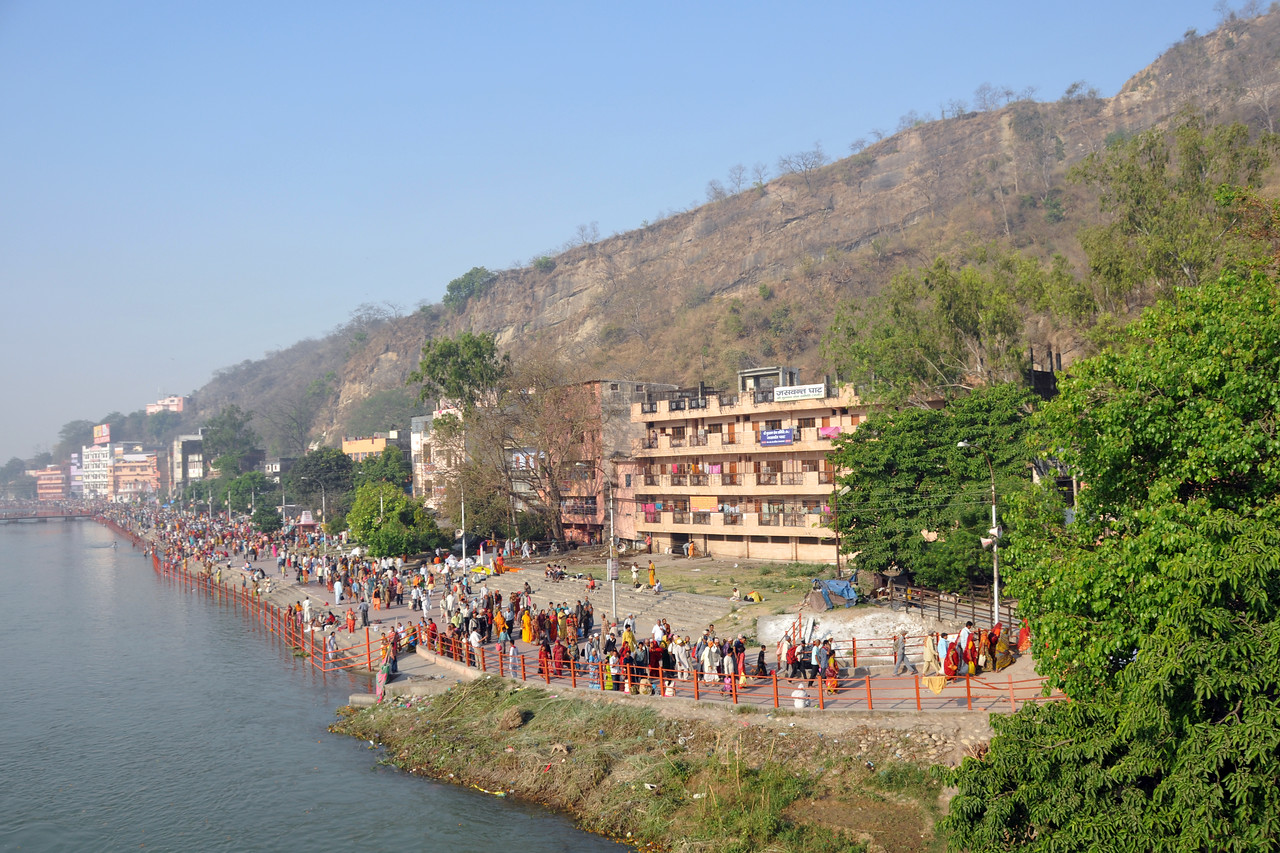 Pilgrims and devotees line the ghats for a puja and a holy dip.<br /> Kumbh Mela is the biggest religious gatherings on the planet which takes places on the banks of the river Ganga. The number of pilgrims this year is expected to exceed around five million since the first day Jan 14 till the time it concludes on April 28, 2010. The auspicious days of the shahi snan or royal baths usually draw hundreds of thousands of devotees to the Har Ki Paudi and other banks of the river. Uttarakhand. North India. The occasion draws pilgrims from around the world and severly overloads the infrastructure so most of the city is shut down for any vehicles other than security or emergency services so a sea of humanity walks through the city to get to the bathing ghats.