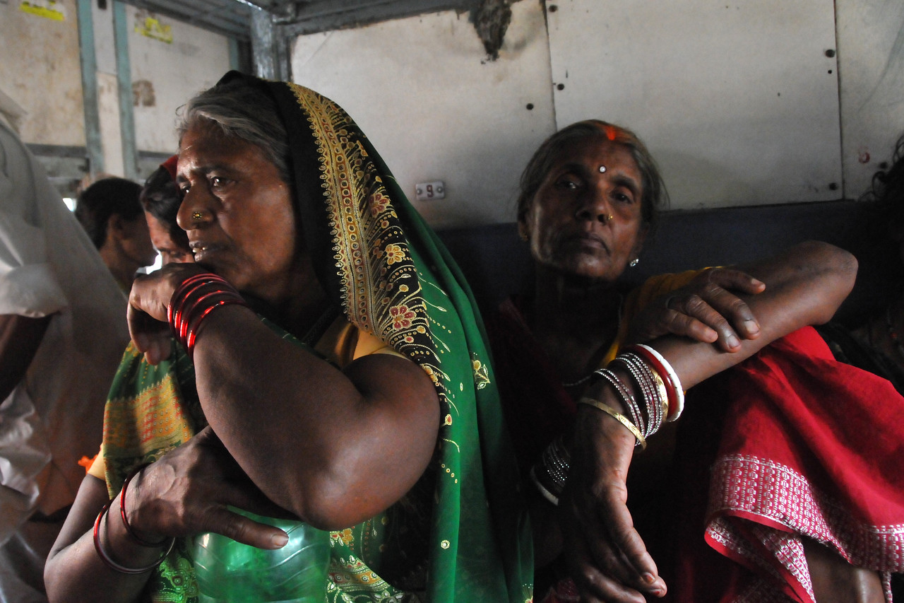 View of the inside of a packed train while had people inside, outside (on top and sides) and in between carriages!<br /> <br /> Due to the Shahi Snan, getting into Haridwar for the Kumbh Mela was a serious challenge as hundreds of thousands of pilgrims poured in. Took an Air India flight from Delhi to Jolly Grant, Dehradun and with a mix of Tempo, bus, rickshaw, train, bike-ride and walk, finally got into the city.<br /> <br /> Kumbh Mela is the biggest religious gatherings on the planet which takes places on the banks of the river Ganga. The number of pilgrims this year is expected to exceed around five million since the first day Jan 14 till the time it concludes on April 28, 2010. The auspicious days of the shahi snan or royal baths usually draw hundreds of thousands of devotees to the Har Ki Paudi and other banks of the river. Uttarakhand. North India.
