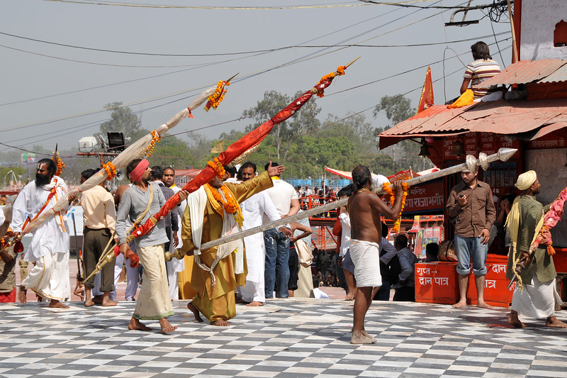Various groups of monks arrive at Har Ki Pauri, Hardwar for the holy bath on the auspicious shahi snan day.<br /> <br /> Kumbh Mela is the biggest religious gatherings on the planet which takes places on the banks of the river Ganga. The number of pilgrims this year is expected to exceed around five million since the first day Jan 14 till the time it concludes on April 28, 2010. The auspicious days of the shahi snan or royal baths usually draw hundreds of thousands of devotees to the Har Ki Paudi and other banks of the river. Uttarakhand. North India. The occasion draws pilgrims from around the world and severly overloads the infrastructure so most of the city is shut down for any vehicles other than security or emergency services so a sea of humanity walks through the city to get to the bathing ghats.