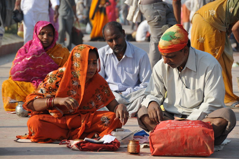 Hindu prayers and poojas being conducted on the river bank of Ganga on the occasion of Kumbh Mela.<br /> <br /> Kumbh Mela is the biggest religious gatherings on the planet which takes places on the banks of the river Ganga. The number of pilgrims this year is expected to exceed around five million since the first day Jan 14 till the time it concludes on April 28, 2010. The auspicious days of the shahi snan or royal baths usually draw hundreds of thousands of devotees to the Har Ki Paudi and other banks of the river. Uttarakhand. North India. The occasion draws pilgrims from around the world and severly overloads the infrastructure so most of the city is shut down for any vehicles other than security or emergency services so a sea of humanity walks through the city to get to the bathing ghats.