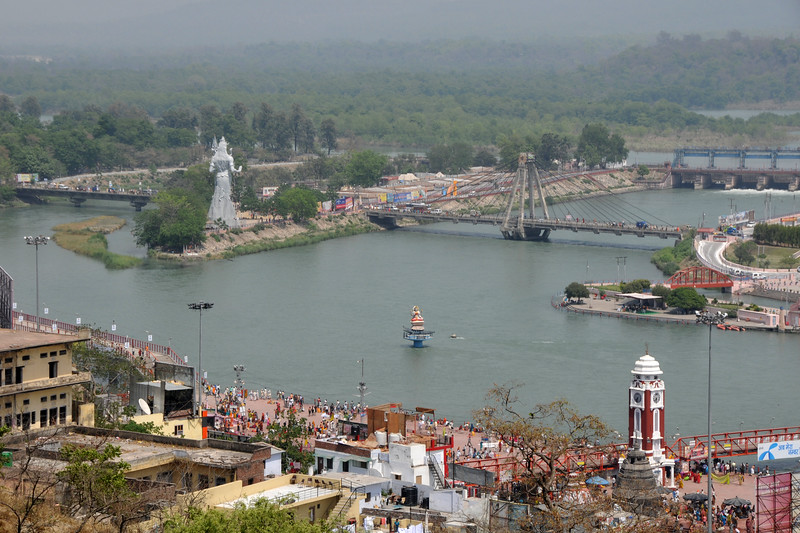 Ariel view of Har Ki Paudi, Haridwar.<br /> <br /> Kumbh Mela is the biggest religious gatherings on the planet which takes places on the banks of the river Ganga. The number of pilgrims this year is expected to exceed around five million since the first day Jan 14 till the time it concludes on April 28, 2010. The auspicious days of the shahi snan or royal baths usually draw hundreds of thousands of devotees to the Har Ki Paudi and other banks of the river. Uttarakhand. North India. The occasion draws pilgrims from around the world and severly overloads the infrastructure so most of the city is shut down for any vehicles other than security or emergency services so a sea of humanity walks through the city to get to the bathing ghats.