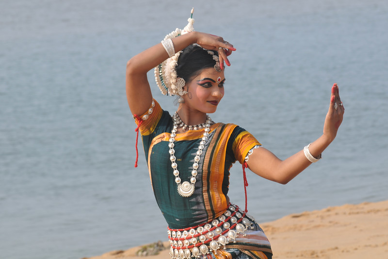 "Rasmi Rekha Mahant Odishi dancer of the Konark Natya Mandap at the Konark Beach shot during the Konark Dance & Music Festival and close to the famous Konark Sun temple.<br /> <br /> These dancers have been mentored by the renowned Odissi dance teacher Guru Gangadhar Pradhan who unfortunately passed away last year. For more details on the festival and the organizers, take a look at:  <a href=""http://konarkfestival.com/"">http://konarkfestival.com/</a> and  <a href=""http://www.konarknatyamandap.org/"">http://www.konarknatyamandap.org/</a>"