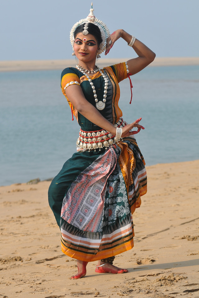 "Rasmi Rekha Mahant striking a pose on the beach. Odissi dancers of the Konark Natya Mandap at the Konark Beach shot during the Konark Dance & Music Festival and close to the famous Konark Sun temple.<br /> <br /> These dancers have been mentored by the renowned Odissi dance teacher Guru Gangadhar Pradhan who unfortunately passed away last year. For more details on the festival and the organizers, take a look at:  <a href=""http://konarkfestival.com/"">http://konarkfestival.com/</a> and  <a href=""http://www.konarknatyamandap.org/"">http://www.konarknatyamandap.org/</a>"