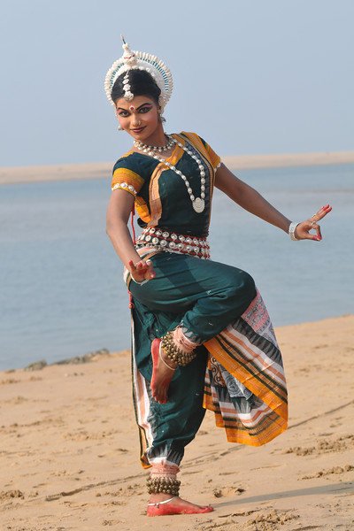"Odissi dancer Rasmi Rekha Mahant striking a pose. She is from the Konark Natya Mandap and shot during the Konark Dance & Music Festival and close to the famous Konark Sun temple.<br /> <br /> These dancers have been mentored by the renowned Odissi dance teacher Guru Gangadhar Pradhan who unfortunately passed away last year. For more details on the festival and the organizers, take a look at:  <a href=""http://konarkfestival.com/"">http://konarkfestival.com/</a> and  <a href=""http://www.konarknatyamandap.org/"">http://www.konarknatyamandap.org/</a>"