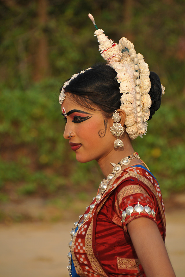 """Interesting head gear and jewellery of Odissi dancer Sonali Gope of the Konark Natya Mandap at the Konark Beach during their shot. The famous Konark Sun temple is close to this location.<br /> <br /> These dancers have been mentored by the renowned Odissi dance teacher Guru Gangadhar Pradhan who unfortunately passed away last year. For more details on the festival and the organizers, take a look at:  <a href=""""http://konarkfestival.com/"""">http://konarkfestival.com/</a> and  <a href=""""http://www.konarknatyamandap.org/"""">http://www.konarknatyamandap.org/</a>"""