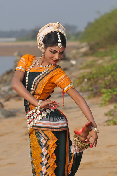 """Thorn in foot"" Rasmi Rekha Mahant enacted by Odissi dancer of the Konark Natya Mandap at the Konark Beach shot during the Konark Dance & Music Festival and close to the famous Konark Sun temple.<br /> <br /> These dancers have been mentored by the renowned Odissi dance teacher Guru Gangadhar Pradhan who unfortunately passed away last year. For more details on the festival and the organizers, take a look at:  <a href=""http://konarkfestival.com/"">http://konarkfestival.com/</a> and  <a href=""http://www.konarknatyamandap.org/"">http://www.konarknatyamandap.org/</a>"