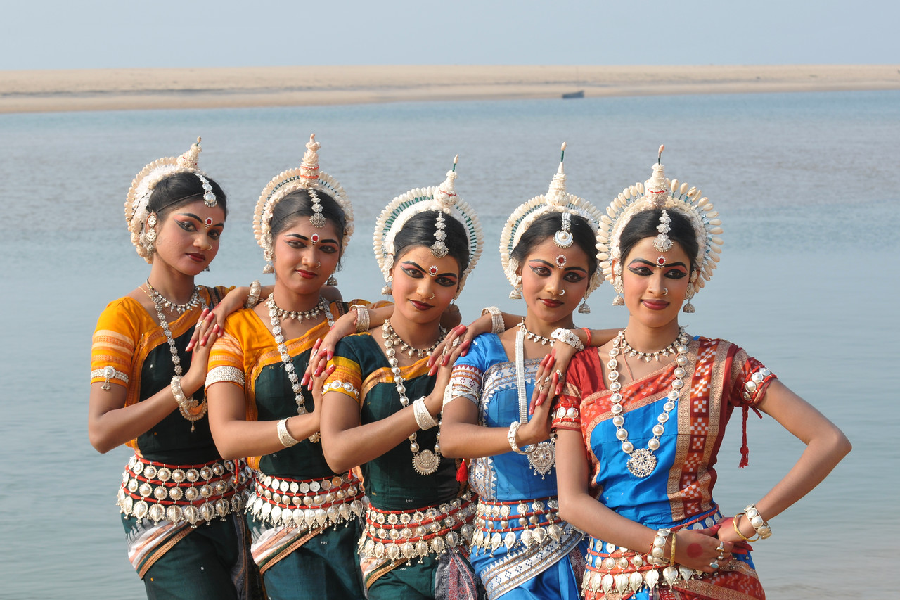 "Odissi dancers of the Konark Natya Mandap at the Konark Beach shot during the Konark Dance & Music Festival and close to the famous Konark Sun temple.<br /> <br /> These dancers have been mentored by the renowned Odissi dance teacher Guru Gangadhar Pradhan who unfortunately passed away last year. For more details on the festival and the organizers, take a look at:  <a href=""http://konarkfestival.com/"">http://konarkfestival.com/</a> and  <a href=""http://www.konarknatyamandap.org/"">http://www.konarknatyamandap.org/</a>"