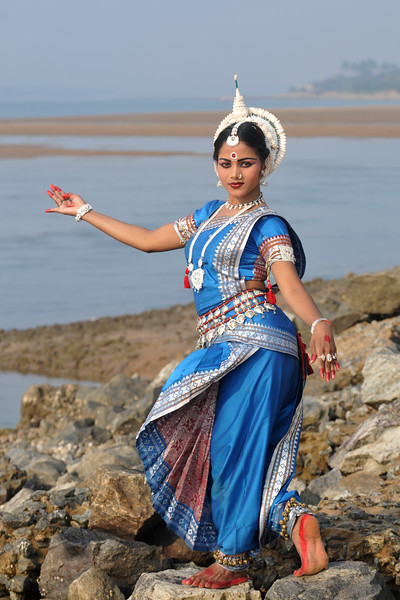 "With the winds blowing and on the rocks. Mita Pradhan, Odissi dancer of the Konark Natya Mandap at the Konark Beach shot during the Konark Dance & Music Festival and located very close to the famous Konark Sun temple.<br /> <br /> These dancers have been mentored by the renowned Odissi dance teacher Guru Gangadhar Pradhan who unfortunately passed away last year. For more details on the festival and the organizers, take a look at:  <a href=""http://konarkfestival.com/"">http://konarkfestival.com/</a> and  <a href=""http://www.konarknatyamandap.org/"">http://www.konarknatyamandap.org/</a>"