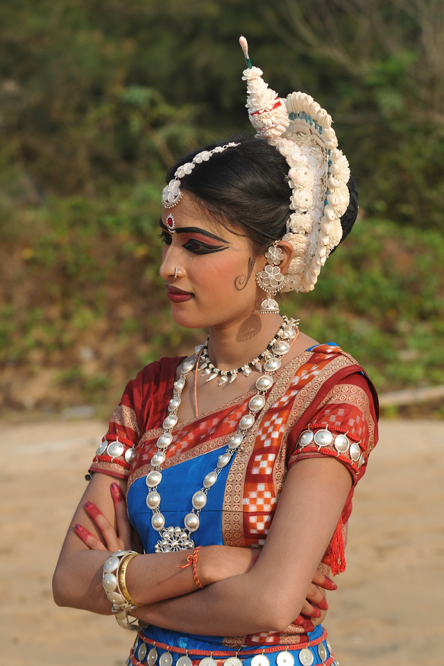 "Odissi dancer kumari Sonali Gope of the Konark Natya Mandap at the Konark Beach shot during the Konark Dance & Music Festival and close to the famous Konark Sun temple.<br /> <br /> These dancers have been mentored by the renowned Odissi dance teacher Guru Gangadhar Pradhan who unfortunately passed away last year. For more details on the festival and the organizers, take a look at:  <a href=""http://konarkfestival.com/"">http://konarkfestival.com/</a> and  <a href=""http://www.konarknatyamandap.org/"">http://www.konarknatyamandap.org/</a>"