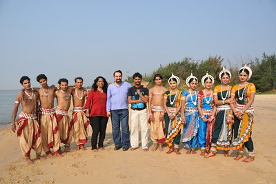 Anu & Suchit with the dancers and their teachers. Odissi dancers of the Konark Natya Mandap at the Konark Beach shot during the Konark Dance & Music Festival and close to the famous Konark Sun temple.  These dancers have been mentored by the renowned Odissi dance teacher Guru Gangadhar Pradhan who unfortunately passed away last year. For more details on the festival and the organizers, take a look at:  http://konarkfestival.com/ and  http://www.konarknatyamandap.org/
