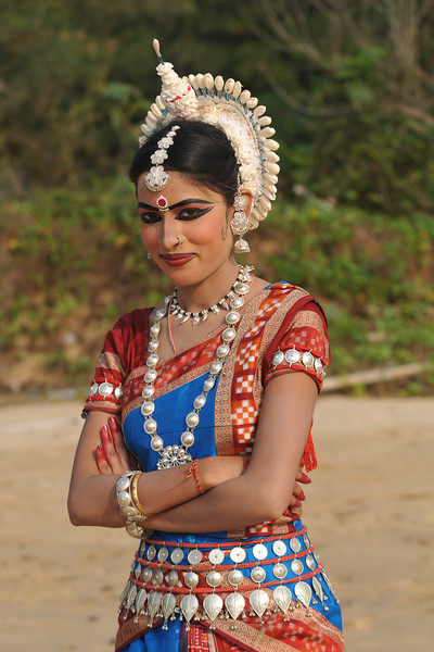 "Sonali Gope, Odissi dancer of the Konark Natya Mandap at the Konark Beach shot during the Konark Dance & Music Festival and close to the famous Konark Sun temple.<br /> <br /> These dancers have been mentored by the renowned Odissi dance teacher Guru Gangadhar Pradhan who unfortunately passed away last year. For more details on the festival and the organizers, take a look at:  <a href=""http://konarkfestival.com/"">http://konarkfestival.com/</a> and  <a href=""http://www.konarknatyamandap.org/"">http://www.konarknatyamandap.org/</a>"