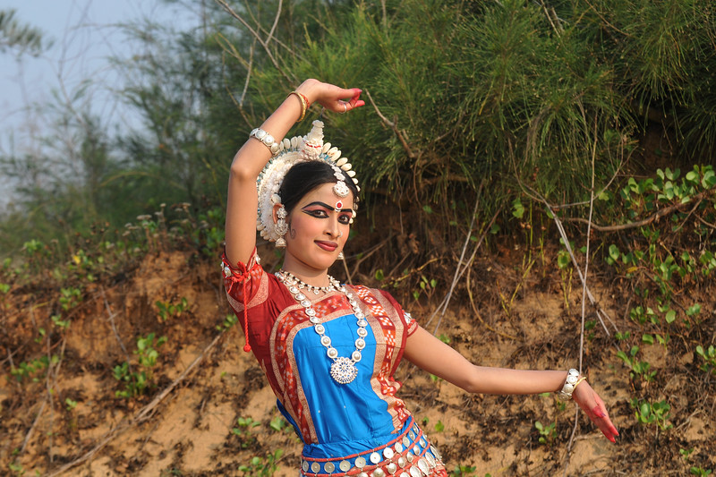 "Odissi dancer, Ms. Sonali Gope, of the Konark Natya Mandap at the Konark Beach shot during the Konark Dance & Music Festival and close to the famous Konark Sun temple.<br /> <br /> These dancers have been mentored by the renowned Odissi dance teacher Guru Gangadhar Pradhan who unfortunately passed away last year. For more details on the festival and the organizers, take a look at:  <a href=""http://konarkfestival.com/"">http://konarkfestival.com/</a> and  <a href=""http://www.konarknatyamandap.org/"">http://www.konarknatyamandap.org/</a>"