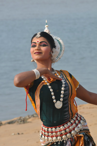 "Odissi dancer, Rasmi Rekha Mahant of the Konark Natya Mandap at the Konark Beach shot during the Konark Dance & Music Festival and close to the famous Konark Sun temple.<br /> <br /> These dancers have been mentored by the renowned Odissi dance teacher Guru Gangadhar Pradhan who unfortunately passed away last year. For more details on the festival and the organizers, take a look at:  <a href=""http://konarkfestival.com/"">http://konarkfestival.com/</a> and  <a href=""http://www.konarknatyamandap.org/"">http://www.konarknatyamandap.org/</a>"