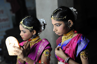 Young girls getting ready before their dance performance.  The Konark Dance & Music Festival 2011 held from February, 19th to 23rd, organized by Konark Natya Mandap. The festival takes place in an open-air auditorium and enlivens the spirit of the sculptures of Konark temple which is just a short distance away.  The objectives of the Konark Natya Mandap are to preserve, promote, and project the rich cultural heritage of Orissa and to infuse cultural awareness in the minds of all. Started with painstaking efforts of internationally renowned Odissi dance teacher Guru Gangadhar Pradhan who unfortunately passed away last year. For more details on the festival see  http://www.konarknatyamandap.org/ and http://konarkfestival.com/