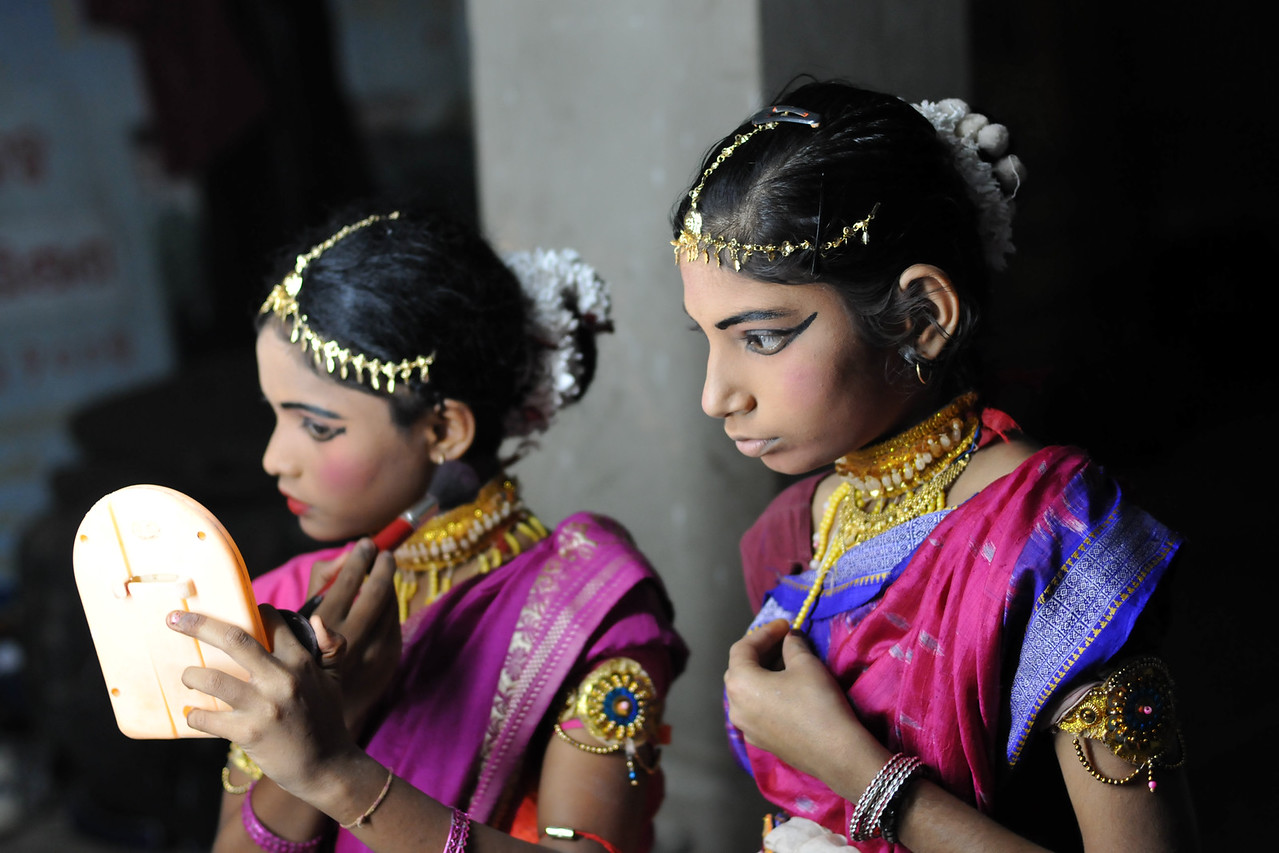 "Young girls getting ready before their dance performance.<br /> <br /> The Konark Dance & Music Festival 2011 held from February, 19th to 23rd, organized by Konark Natya Mandap. The festival takes place in an open-air auditorium and enlivens the spirit of the sculptures of Konark temple which is just a short distance away.<br /> <br /> The objectives of the Konark Natya Mandap are to preserve, promote, and project the rich cultural heritage of Orissa and to infuse cultural awareness in the minds of all. Started with painstaking efforts of internationally renowned Odissi dance teacher Guru Gangadhar Pradhan who unfortunately passed away last year. For more details on the festival see  <a href=""http://www.konarknatyamandap.org/"">http://www.konarknatyamandap.org/</a> and <a href=""http://konarkfestival.com/"">http://konarkfestival.com/</a>"