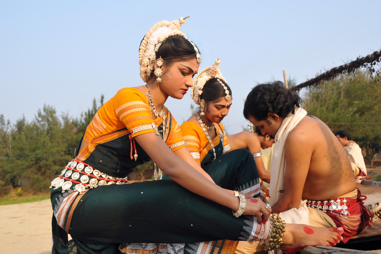 """Odissi dancers of the Konark Natya Mandap at the Konark beach getting ready for the shoot. Close to the famous Konark Sun temple these dancers have been mentored by the renowned Odissi dance teacher Guru Gangadhar Pradhan who unfortunately passed away last year. For more details on the festival and the organizers, take a look at:  <a href=""""http://konarkfestival.com/"""">http://konarkfestival.com/</a> and  <a href=""""http://www.konarknatyamandap.org/"""">http://www.konarknatyamandap.org/</a>"""