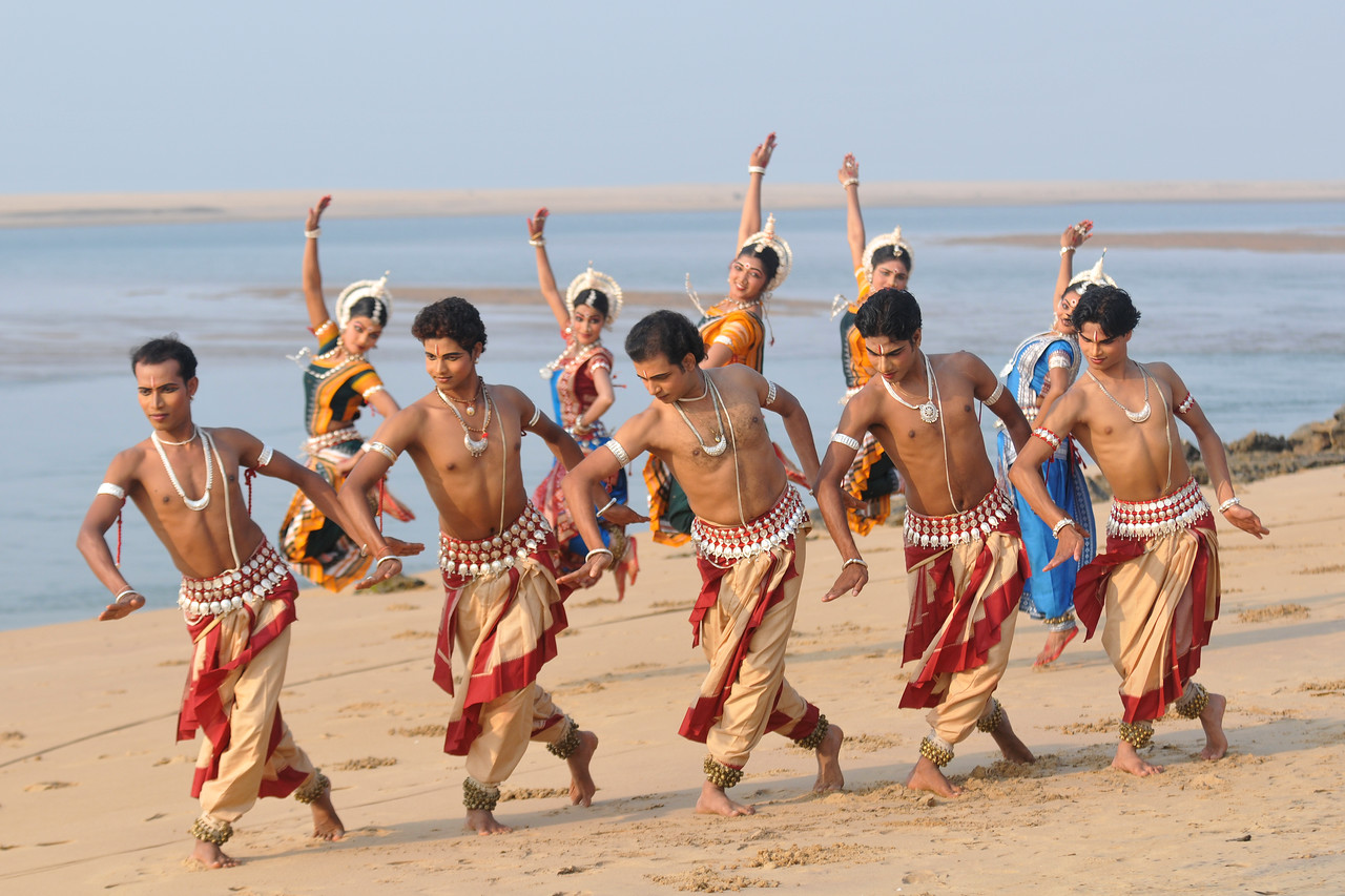 """Odissi dancers of the Konark Natya Mandap at the Konark Beach shot during the Konark Dance & Music Festival and close to the famous Konark Sun temple.<br /> <br /> These dancers have been mentored by the renowned Odissi dance teacher Guru Gangadhar Pradhan who unfortunately passed away last year. For more details on the festival and the organizers, take a look at:  <a href=""""http://konarkfestival.com/"""">http://konarkfestival.com/</a> and  <a href=""""http://www.konarknatyamandap.org/"""">http://www.konarknatyamandap.org/</a>"""