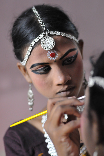 "Elder girls help the younger dancers in getting ready by applying make-up.<br /> <br /> The Konark Dance & Music Festival 2011 held from February, 19th to 23rd, organized by Konark Natya Mandap. The festival takes place in an open-air auditorium and enlivens the spirit of the sculptures of Konark temple which is just a short distance away.<br /> <br /> The objectives of the Konark Natya Mandap are to preserve, promote, and project the rich cultural heritage of Orissa and to infuse cultural awareness in the minds of all. Started with painstaking efforts of internationally renowned Odissi dance teacher Guru Gangadhar Pradhan who unfortunately passed away last year. For more details on the festival see  <a href=""http://www.konarknatyamandap.org/"">http://www.konarknatyamandap.org/</a> and <a href=""http://konarkfestival.com/"">http://konarkfestival.com/</a>"