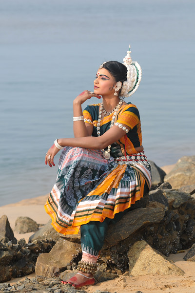"Odissi dancer Smt. Rasmi Rekha Mahant of the Konark Natya Mandap at the Konark Beach shot during the Konark Dance & Music Festival and close to the famous Konark Sun temple.<br /> <br /> These dancers have been mentored by the renowned Odissi dance teacher Guru Gangadhar Pradhan who unfortunately passed away last year. For more details on the festival and the organizers, take a look at:  <a href=""http://konarkfestival.com/"">http://konarkfestival.com/</a> and  <a href=""http://www.konarknatyamandap.org/"">http://www.konarknatyamandap.org/</a>"