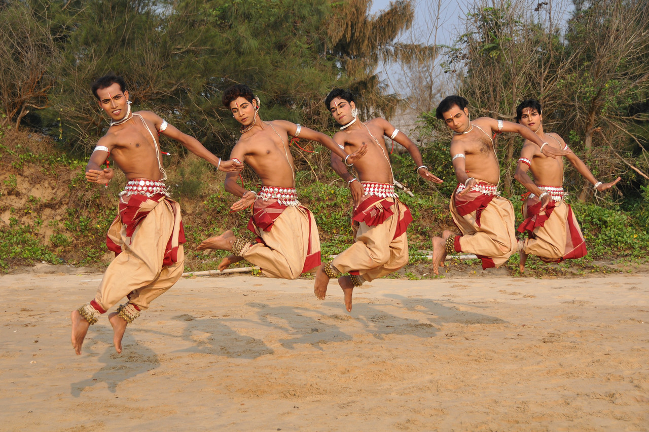 """Male Odissi dancers jump in the air during their shoot at the Konark beach close to the famous Konark Sun temple.<br /> <br /> These dancers have been mentored by the renowned Odissi dance teacher Guru Gangadhar Pradhan who unfortunately passed away last year. For more details on the festival and the organizers, take a look at:  <a href=""""http://konarkfestival.com/"""">http://konarkfestival.com/</a> and  <a href=""""http://www.konarknatyamandap.org/"""">http://www.konarknatyamandap.org/</a>"""