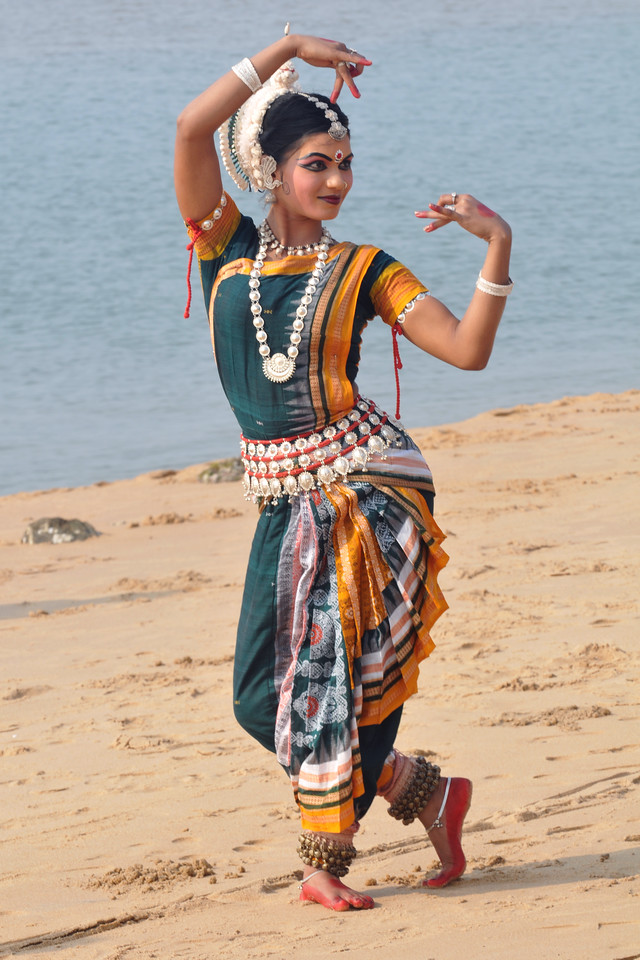 "Odishi dancer Rasmi Rekha Mahant of the Konark Natya Mandap at the Konark Beach shot during the Konark Dance & Music Festival and close to the famous Konark Sun temple.<br /> <br /> These dancers have been mentored by the renowned Odissi dance teacher Guru Gangadhar Pradhan who unfortunately passed away last year. For more details on the festival and the organizers, take a look at:  <a href=""http://konarkfestival.com/"">http://konarkfestival.com/</a> and  <a href=""http://www.konarknatyamandap.org/"">http://www.konarknatyamandap.org/</a>"