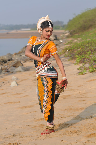 "Ms. Rasmi Rekha Mahant - Odissi dancer of the Konark Natya Mandap enacting the ""thorn in foot"" at the Konark Beach shot during the Konark Dance & Music Festival and close to the famous Konark Sun temple.<br /> <br /> These dancers have been mentored by the renowned Odissi dance teacher Guru Gangadhar Pradhan who unfortunately passed away last year. For more details on the festival and the organizers, take a look at:  <a href=""http://konarkfestival.com/"">http://konarkfestival.com/</a> and  <a href=""http://www.konarknatyamandap.org/"">http://www.konarknatyamandap.org/</a>"