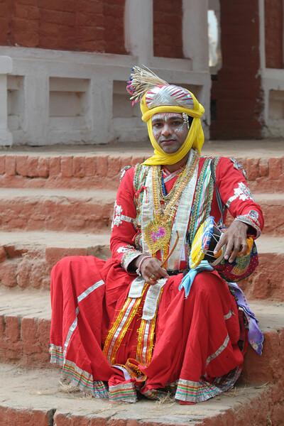 Manilal Malviya from Jila Harda, MP (Madhya Pradesh) with his damru.<br /> Artists at the Surajkund Crafts Mela 2009, Haryana, North India. The Suraj Kund Mela is an annual fair held near Delhi. Folk dances, musical performances, handicrafts on display & sale and and a lot of fun & excitement for everyone.