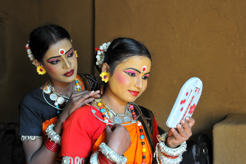 Smt. Sarita Mohanty from Dayal Sangeet Academy, Rasulgargh, Bhubaneshwar, Orissa getting ready by doing up her hair and face for the Odissi and Sambalpuri folk dance at Surakund Mela 2010. The Suraj Kund Crafts Mela 2010 is an annual fair held in Haryana near Delhi in February.