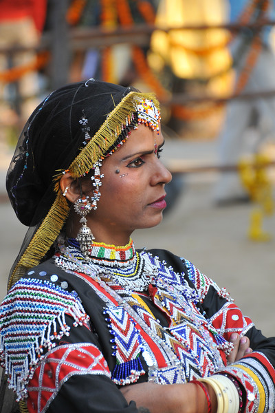 Rajki Sapera troupe near the open threatre called Chaupal before their performance. Rajki Sapera and her troupe have been performing traditional Rajasthani dances for past 15 years in the mela (fair). The Suraj Kund Crafts Mela 2010 is an annual fair held near Delhi in February. Visitors get to experience folk dances, handicrafts and taste lots of delicious food.