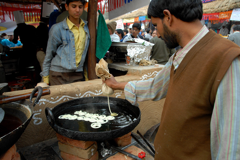 Hot jalebi being made at Suraj Kund Mela 2008 held in Haryana (outskirts of Delhi), North India. The Suraj Kund Mela is an annual fair held near Delhi. Folk dances, handicrafts and a lot of fun.