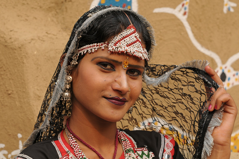 Artists from Rajki-Puran Nath Sapera & Party, Jaipur photographed at the Suraj Kund Mela 2009 held in Haryana (outskirts of Delhi), North India. The Suraj Kund Mela is an annual fair held near Delhi. Folk dances, handicrafts and a lot of fun.