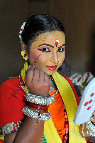 Smt. Sarita Mohanty from Dayal Sangeet Academy, Rasulgargh, Bhubaneshwar, Orissa getting ready for the Odissi and Sambalpuri folk dance at Surakund Mela 2010. The Suraj Kund Crafts Mela 2010 is an annual fair held in Haryana near Delhi in February.