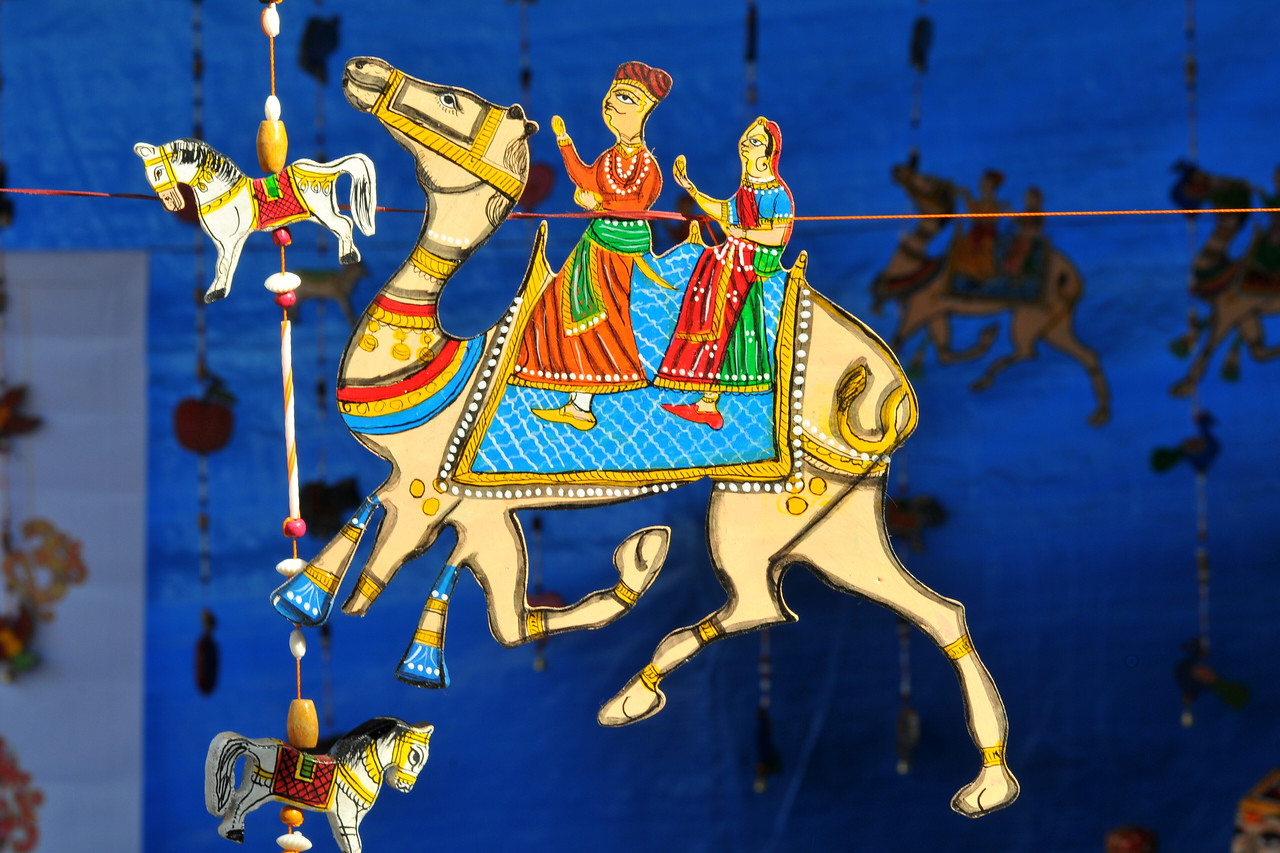 Rajasthani camels and horses with people - decorative items. Plenty of opportunity for shopping deals, bargains and purchases or just enjoy the performances at the Surjakund Crafts Mela 2010 held in February in Faridabad, Haryana, India.