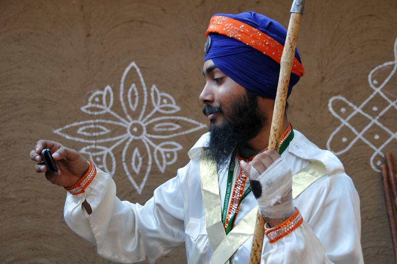 Sikh artists from Patiala in Nihang's martial art dress with weapons which includes cellphones.<br /> <br /> <br /> Surajkund Crafts Mela 2011 held near Delhi in Faridabad, Haryana, North India. The annual Suraj Kund Mela (fair) is an event held in February each year where artisans, craftsmen, musicians & dancers come together and entral thousands of visitors. It is also a great shopping bonanza and delight to the palate with the range of food.