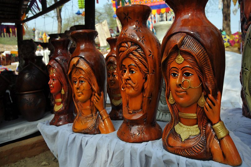 Art and artifacts at Suraj Kund Mela.<br /> <br /> Surajkund Crafts Mela 2011 held near Delhi in Faridabad, Haryana, North India. The annual Suraj Kund Mela (fair) is an event held in February each year where artisans, craftsmen, musicians & dancers come together and entral thousands of visitors. It is also a great shopping bonanza and delight to the palate with the range of food.