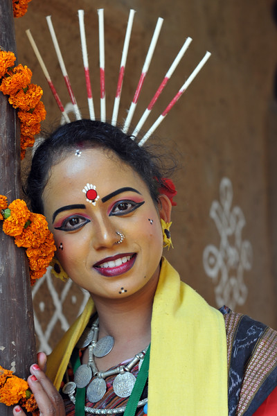 Portrait of Ms. Nandita Tripathi from Dayal Sangeet Academy, Rasulgargh, Bhubaneshwar, Orissa who is an Odissi and Sambalpuri folk dancer stikes a pose at Surakund Mela.<br /> Surajkund Crafts Mela 2011 held near Delhi in Faridabad, Haryana, North India. The annual Suraj Kund Mela (fair) is an event held in February each year where artisans, craftsmen, musicians & dancers come together and entral thousands of visitors. It is also a great shopping bonanza and delight to the palate with the range of food.