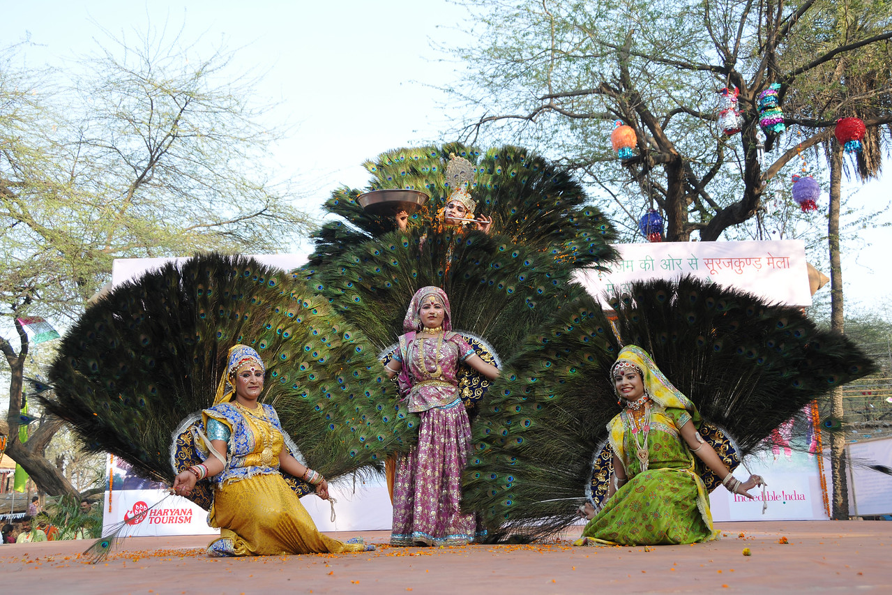 Dance performers at the open theatre called Chaupal at the Suraj Kund Crafts Mela. This dance was by  Goverdhan (Mathura) who perform the Birj Ki Holi (Radha Kishan). <br /> <br /> Surajkund Crafts Mela 2011 held near Delhi in Faridabad, Haryana, North India. The annual Suraj Kund Mela (fair) is an event held in February each year where artisans, craftsmen, musicians & dancers come together and entral thousands of visitors. It is also a great shopping bonanza and delight to the palate with the range of food.