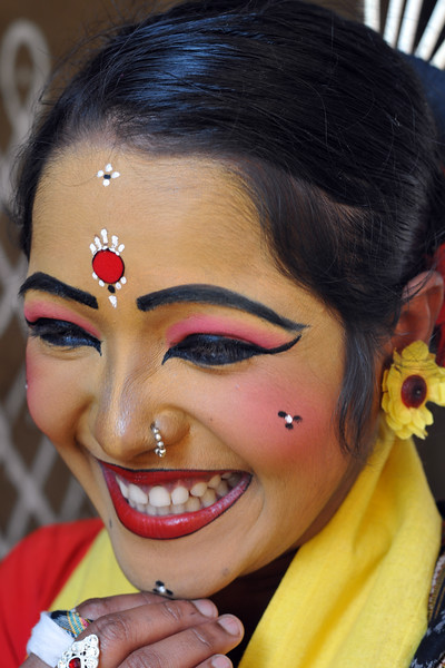 Close up picture of Prativa Mohanty, dancer from Dayal Sangeet Academy, Rasulgargh, Bhubaneshwar, Orissa striking a pose at Suraj Kund Mela. She is an Odissi and Sambalpuri folk dancer. <br /> Surajkund Crafts Mela 2011 held near Delhi in Faridabad, Haryana, North India. The annual Suraj Kund Mela (fair) is an event held in February each year where artisans, craftsmen, musicians & dancers come together and entral thousands of visitors. It is also a great shopping bonanza and delight to the palate with the range of food.