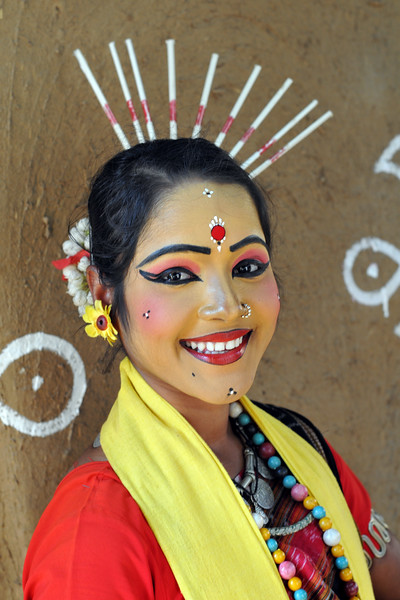 Portrait picture of dancer Prativa Mohanty from Dayal Sangeet Academy, Rasulgargh, Bhubaneshwar, Orissa striking a pose at Suraj Kund Mela. She is an Odissi and Sambalpuri folk dancer. <br /> Surajkund Crafts Mela 2011 held near Delhi in Faridabad, Haryana, North India. The annual Suraj Kund Mela (fair) is an event held in February each year where artisans, craftsmen, musicians & dancers come together and entral thousands of visitors. It is also a great shopping bonanza and delight to the palate with the range of food.